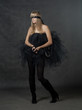 female beauty-portrait with tutu in front of a dark background