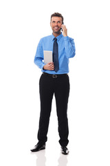 Smiling businessman with electronic equipment