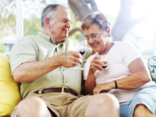 senior couple drinking wine outside on patio