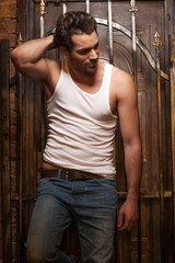 Sexy man in white T-shirt and jeans
