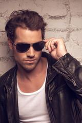 Portrait of sexy man in sun glasses.