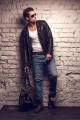 Sexy man with handbag.