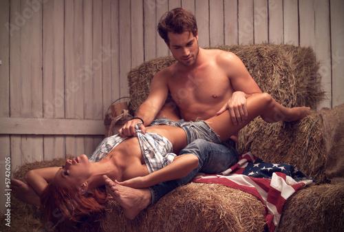 Sexy couple having sex in hayloft. Sexy man with nude torso