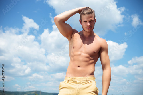 topless man outdoor passing hand through hair