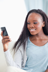 Close up of woman reading text message