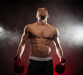 Low angle view of a fit caucasian boxer