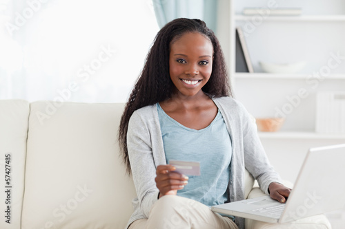 Woman shopping online in living room