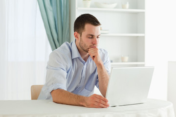 Businessman working concentrated on his notebook