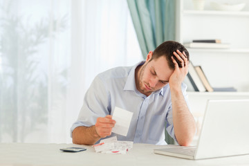 Businessman worried about bills