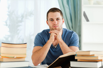 Student sitting at his desk thinking