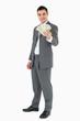 Smiling businessman presenting banknotes