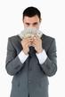 Businessman smelling bank notes
