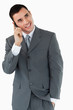 Smiling businessman looking diagonally upwards while on the phon