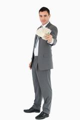 Businessman presenting banknotes