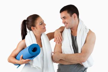 Healthy couple going to practice yoga