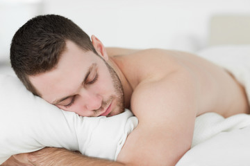 Man lying on his belly while sleeping