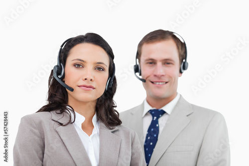Young call center agents standing together