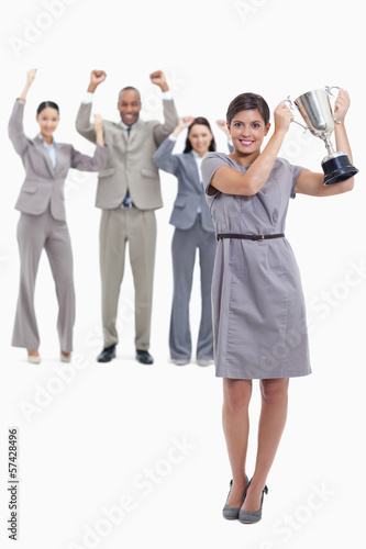 Woman holding a cup with happy co-workers