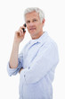 Portrait of a man making a phone call while looking at the camer