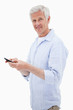 Portrait of a man using his mobile phone while looking at the ca
