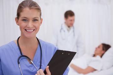 Smiling surgeon standing