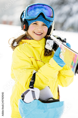 Skiing, winter sports - portrait of happy young skier - 57429242