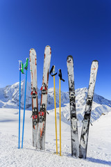Skiing,  mountains and ski equipments on ski run