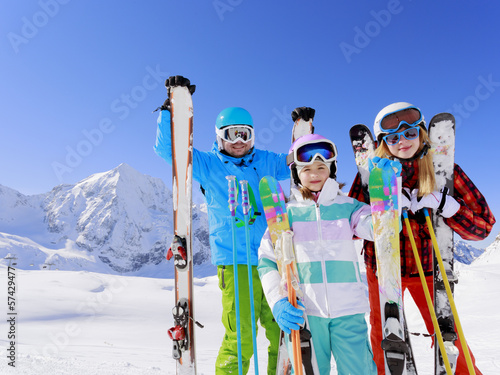 Ski,  sun and fun - family enyoing winter vacation