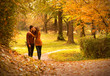 Kiss in autumn park.