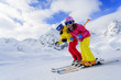 Ski, sun and winter fun - skiers enjoying ski vacation