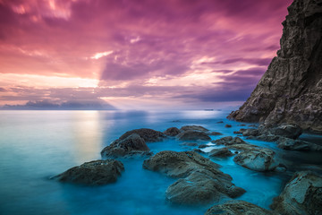 Sunset panorama over sea and rocks