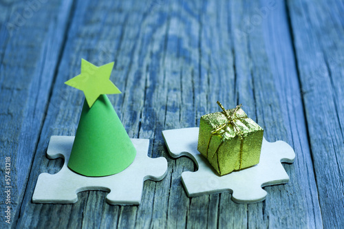 Abstract christmas tree and gift on puzzle concept