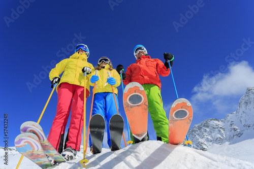 Ski, snow, sun and fun - family enjoying winter