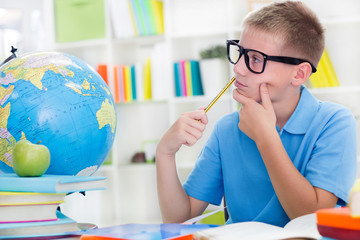 Little boy studying about the world,and thinkig something