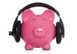 Piggy bank wearing headphones