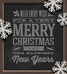 Christmas greetings on a chalkboard and paper snowflakes