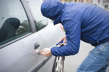 thief stealing car