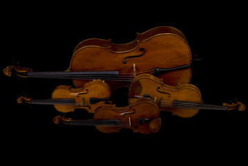 Two Violins, Viola and Cello isolated on black