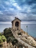 Alassio  chapel by the sea in a stormy day