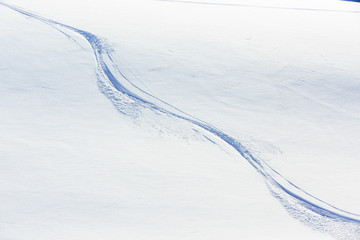 Ski background - freeride tracks on powder snow