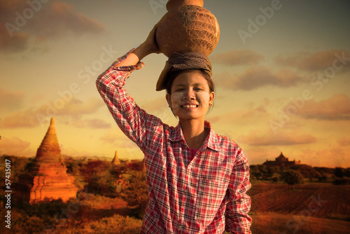 happy asian traditional farmer harvest at myanmar, bagan carryin