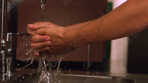 Hands washing under water tap