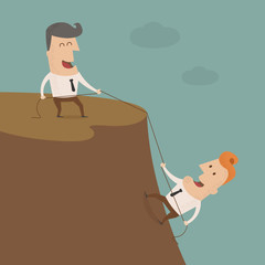 Businessman on the top of a rock helping an other businessman to