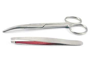 Nail scissors with  eyebrow tweezers isolated on  white