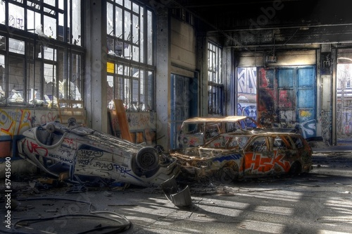 Old cars in an abandoned hall - 57435690