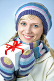 Beautiful winter woman with gift