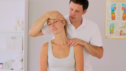 Physiotherapist manipulating his patients neck