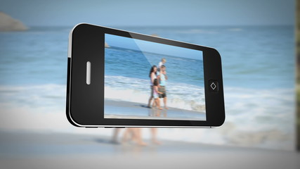 Smartphone displaying family outdoors