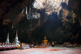 Giant Buddha in Thai cave