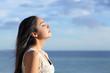 Profile of a beautiful arab woman breathing fresh air